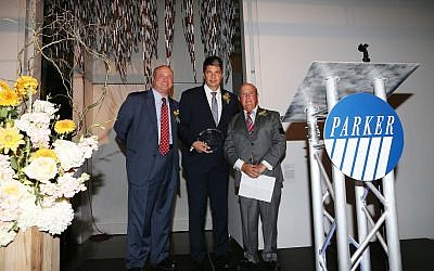 (L-R) Parker's Michael N. Rosenblut, presents award to Carrier's John S. Moore, with Parker's Peter Seideman, at Gala fundraising dinner held in the Queens Museum.
