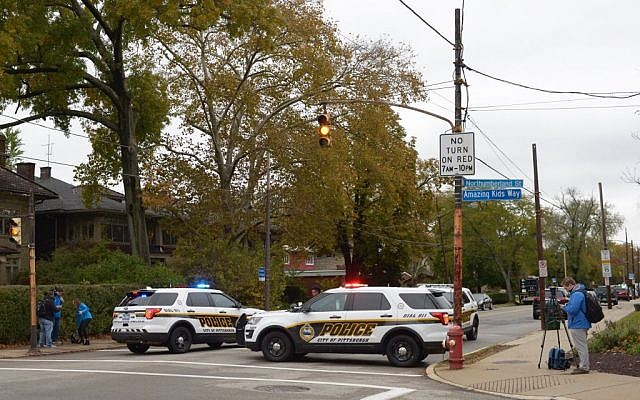 """Police block a road near the Tree of Life Synagogue, after a gunman opened fire inside at Squirrel Hill, Pennsylvania on October 27, 2018. - A synagogue shooting in Pittsburgh is """"likely the deadliest attack on the Jewish community in the history of the United States,"""" an American civil rights group. (Photo by Dustin Franz / AFP)        (Photo credit should read DUSTIN FRANZ/AFP/Getty Images)"""