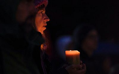 A woman holds a candle during a vigil in Squirrel Hill, Pennsylvania on October 27, 2018, to remember those that died in the Tree of Life Synagogue shooting earlier in the day. - The gunman who killed 11 people at a synagogue in Pittsburgh will face federal charges that carry the death penalty, the US Justice Department said. Getty Images