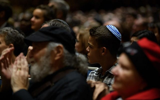 PITTSBURGH, PA - OCTOBER 28: People listen to interfaith speakers at the Soldiers and Sailors Memorial Hall before a service to honor and mourn the victims of Saturday's mass shooting at the Tree Of Life Synagogue on October 28, 2018 in Pittsburgh, Pennsylvania. Eleven people were killed and six more were wounded in the mass shooting that police say was fueled by antisemitism. (Photo by Jeff Swensen/Getty Images)