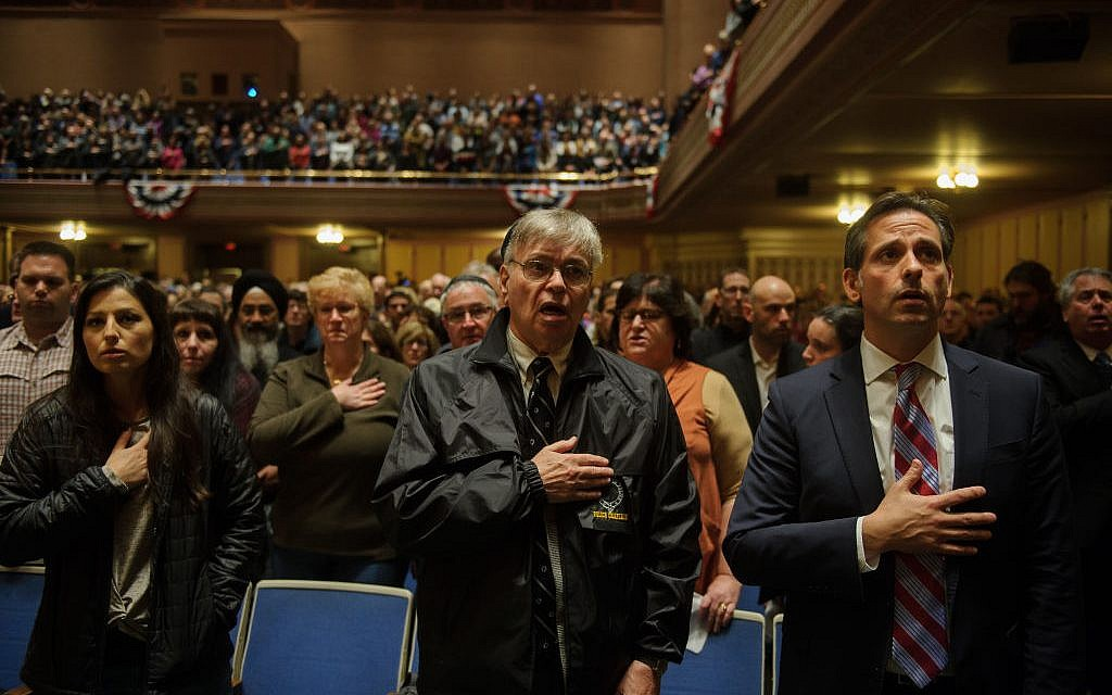 People listen to interfaith speakers at the Soldiers and Sailors Memorial Hall during a service to honor and mourn the victims of Saturday's mass shooting at the Tree Of Life Synagogue on October 28, 2018 in Pittsburgh, Pennsylvania. Eleven people were killed and six more were wounded in the mass shooting that police say was fueled by antisemitism. Getty Images