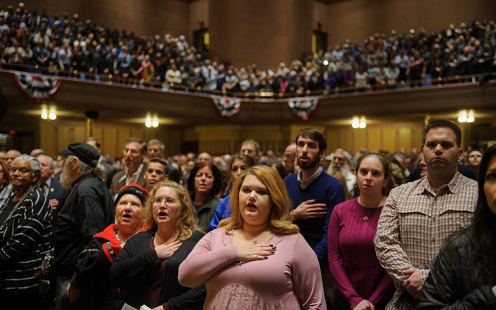 PITTSBURGH, PA - OCTOBER 28: People listen to interfaith speakers at the Soldiers and Sailors Memorial Hall during a service to honor and mourn the victims of Saturday's mass shooting at the Tree Of Life Synagogue on October 28, 2018 in Pittsburgh, Pennsylvania. Eleven people were killed and six more were wounded in the mass shooting that police say was fueled by antisemitism. (Photo by Jeff Swensen/Getty Images)