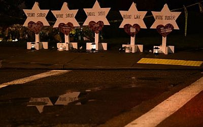 The names of the victims are displayed at a memorial on October 28, 2018 outside the Tree of Life synagogue after a shooting there left 11 people dead in Pittsburgh on October 27.  Getty Images
