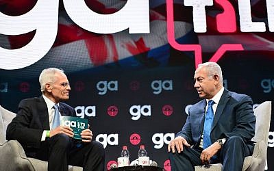 Prime Minister Benjamin Netanyahu is interviewed onstage by Jewish Federations of North America Chairman Richard Sandler at the General Assembly in Tel Aviv, Oct. 24, 2018. JTA