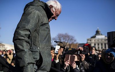 Bernie Sanders leaves after speaking at a rally against the Republican tax plan in Washington, D.C., Dec. 13, 2017. JTA