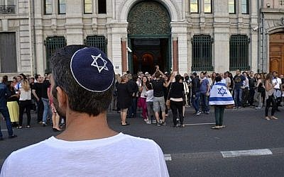 A man wearing a kipah looks on, as people take part in a demonstration called by the Representative Council of Jewish Institutions in France on July 31, 2014, in front of a Lyon synagogue. (AFP/Romain LaFabregue/File)