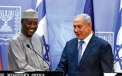 Israeli Prime Minister Benjamin Netanyahu shakes hands Sunday with Chadian President Idriss Deby, the first president of his country to visit Israel. Getty Images