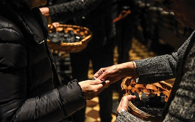 A tear in the fabric: Black ribbons called kriyah are handed out to people at a Central Synagogue vigil for the Pittsburgh shul massacre victims. Getty Images