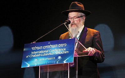 "Rabbi Yisroel Rosenfeld, director of Chabad of Western Pennsylvania, taught a text pertaining to the 11 dead: ""All Israel has a portion in the World to Come. … Your people are all righteous."" Itzik Roytman / Chabad.org"