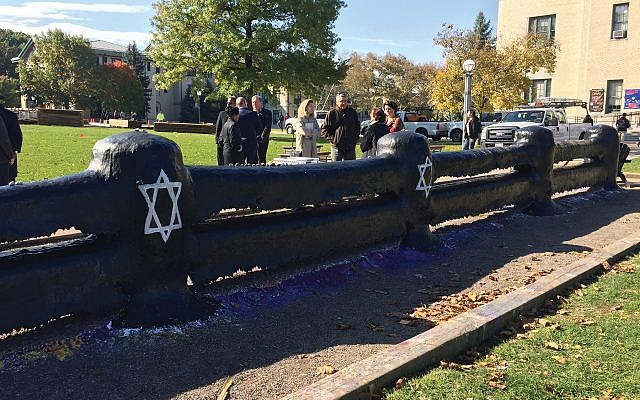 Students joined together to paint The Fence on CMU's campus. During the week following the shooting, rocks were available for members of the campus community to place on top of The Fence. Jadon Grove