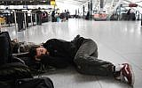 Passengers stranded last week at JFK waiting it out. Getty Images