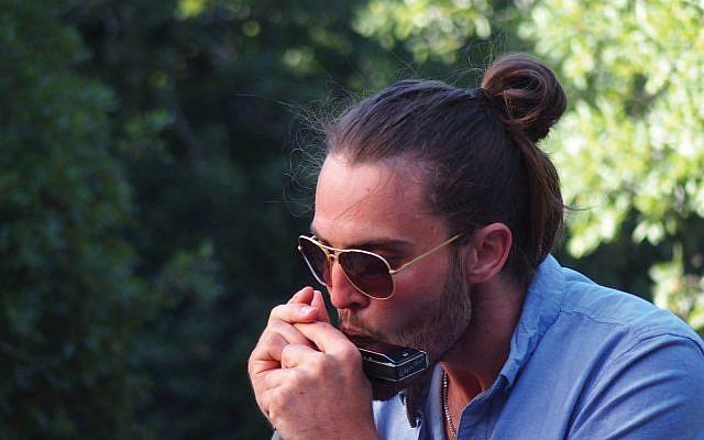 Yotam Ben-Or swings on jazz harmonica. Aicf.org