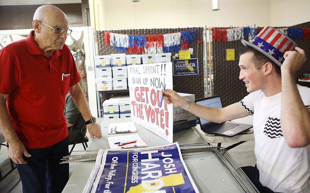 A  campaign volunteer talks to a local supporter. Getty Images