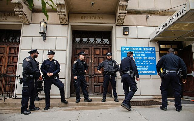 NYPD officers stand guard at the door of the Union Temple of Brooklyn on November 2, 2018 in New York City. Getty Images