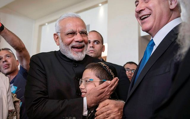 Indian Prime Minister Narendra Modi (C-L) embraces Moshe Holtzberg (C), son of slain US Rabbi Gavriel Holtzberg who was killed with his wife in the November 26, 2008 attacks on the Nariman Chabad house in Mumbai, during a meeting with the boy and with other relatives, accompanied by Israeli Prime Minister Benjamin Netanyahu (R) at the King David Hotel in Jerusalem on July 5, 2017.  Getty Images