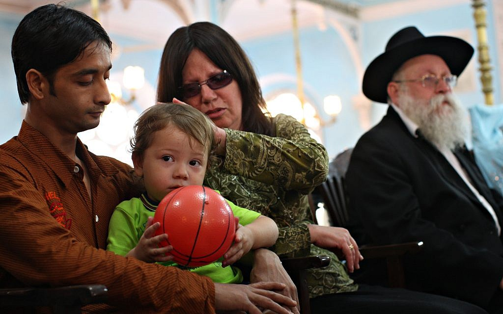 Moshe Holtzberg plays with a ball alongside his grandparents during a memorial ceremony for his parents Rivka (28) and Gavriel (29) who were killed at the Nariman House terrorist attack, at the Keneseth Eliyahoo synagogue on December 01, 2008 in Mumbai, India. Getty Images