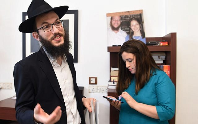 In this photograph taken on January 12, 2018, Chabad Mumbai Director Rabbi Israel Kozlovsky speaks to reporters about a forthcoming memorial for the victims of the 26/11 terror attack as his wife and co-director Chaya Kozlovsky looks on at their home in Mumbai. Getty Images