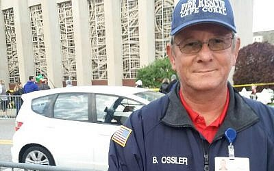 """Chaplain Bob Ossler in front of Tree of Life Congregation this week. """"I saw people just sitting there stunned, just frozen — stunned and awed by what happened. I would just listen to people share."""" Shira Hanau/JW"""