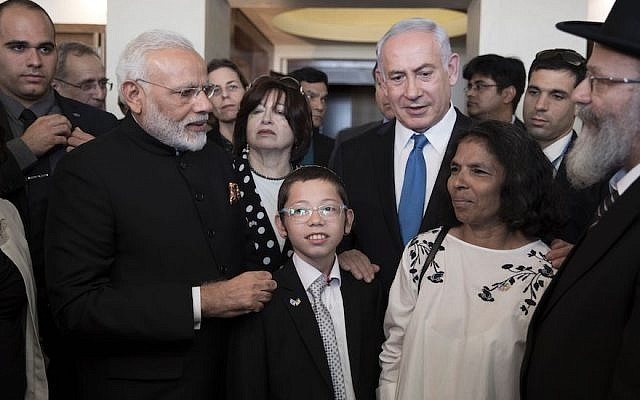 Indian Prime Minister Narendra Modi, left, and Israeli Prime Minister Benjamin Netanyahu, in the blue tie, meet with Moshe Holtzberg and his nanny Sandra Samuel at the Nariman Chabad House in Mumbai, the site of the 2008 terrorist attack that left Moshe's parents dead, July 5, 2017. JTA