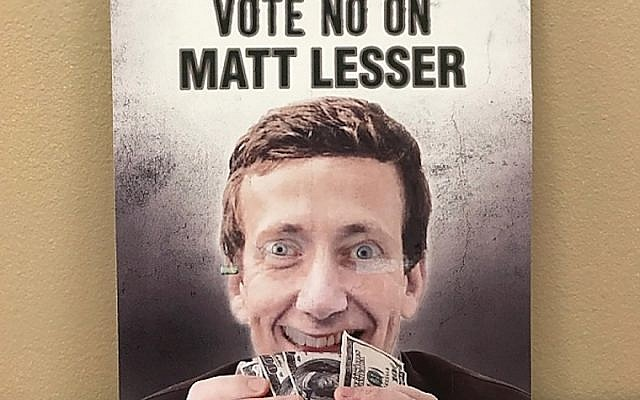 Democratic State Rep. Matt Lesser clutches a handful of $100 bills in a mailer sent by his Republican opponent for the Connecticut State Senate, Ed Charamut. (JTA)