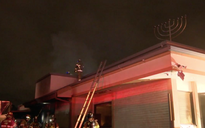 A view of the burning Torah Vachesed synagogue in southwest Houston. (JTA)