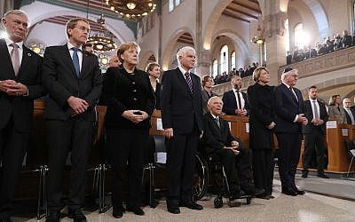 From left to right: Former German President Horst Koehler, politician Daniel Guenther, Chancellor Angela Merkel and Central Council of Jews President Josef Schuster, Bundestag President Wolfgang Schaeuble, first lady Elke Buendenbender and German President Frank-Walter Steinmeier attend a ceremony at the Rykestrasse Synagogue in Berlin to commemorate the 1938 Kristallnacht pogroms. JTA