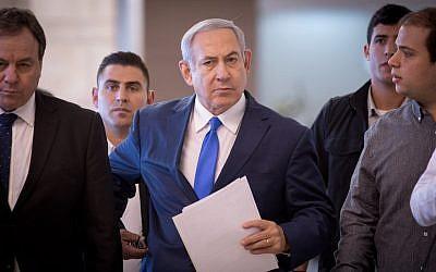 Israeli Prime Minister Benjamin Netanyahu arrives at the Knesset in Jerusalem for a faction meeting, Nov. 19, 2018. (JTA)