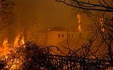 Flames surround a house in Malibu, Calif., Nov. 9, 2018. The Woolsey fire has led to the evacuation of about 75,000 homes in Southern California. JTA