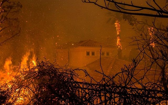 Flames surround a house in Malibu, Calif., Nov. 9, 2018. The Woolsey fire has led to the evacuation of about 75,000 homes in Southern California. (JTA)