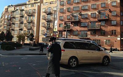 A haredi Orthodox man crosses the street in Williamsburg, Brooklyn. (JTA)