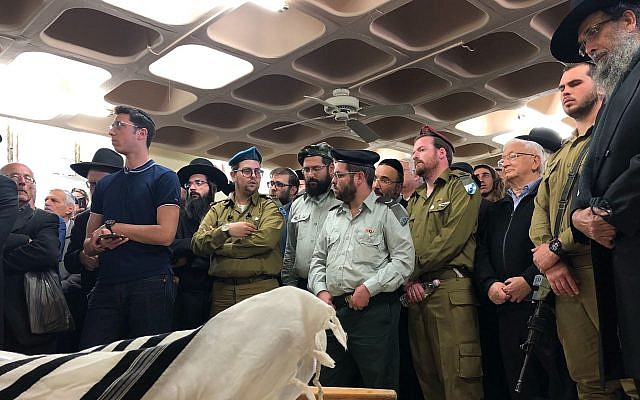 Members of the haredi Orthodox Netzach Yehuda battalion mourn the death of Yosef Cohen at his funeral, Dec. 14, 2018. (Sam Sokol via JTA)