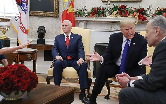 President Trump, second from right, in White House meeting with Democratic congressional leaders, cited Israel's security proof as support for a fence on the US southern border. At right is Sen. Chuck Schumer, minority leader. At left, unseen, is House Minority Leader Nancy Pelosi.  GETTY IMAGES