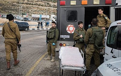 Israeli security forces at the scene of a shooting attack at the entrance to the Israeli settlement of Givat Asaf, in the West Bank, Dec. 13, 2018. (Hadas Parush/Flash90 via JTA)