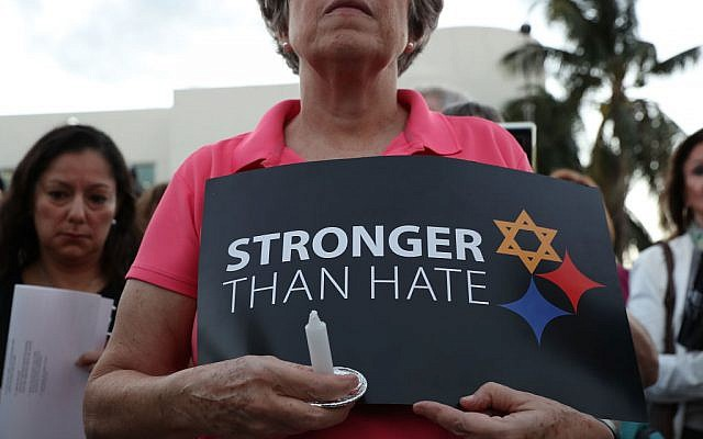A person holds a sign that reads, 'Stronger than Hate,' as she joins with others for a Community-Wide Solidarity Vigil at the Holocaust Memorial Miami Beach to remember the victims of the mass shooting at a Pittsburgh temple on October 30, 2018 in Miami Beach, Florida. Eleven people were killed in an attack at the Tree of Life Congregation in Pittsburgh's Squirrel Hill neighborhood on Oct. 27. Getty Images
