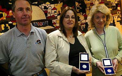 Rona Ramon (C), wife of Israeli astronaut Ilan Ramon, stands with Evelyn Husband (R), wife of Commander Rick Husband, and NASA astronaut Dr. Stephen Robinson, as the families of the crew of the ill-fated Columbia space shuttle arrive at Israel's Ben Gurion Airport March 14, 2004 in Israel. Getty Images