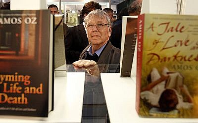 Israeli author, Armos Oz,poses among his books in the hall of  Millenaris Culture Center of Budapest on April 22, 2010 at the 17th International Book Festival of Budapest. Getty Images