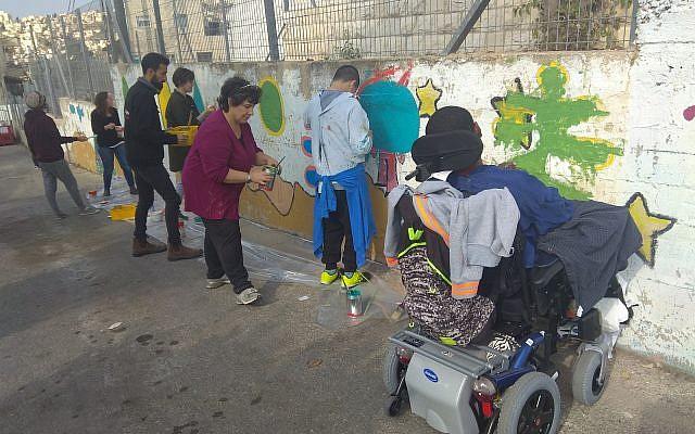 Volunteering at Jerusalem's Ilanot School . Courtesy of Jason Edelstein