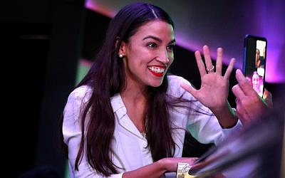 Alexandria Ocasio-Cortez celebrates her victory as the youngest woman elected to Congress at La Boom night club in Queens, Nov. 6, 2018. (Rick Loomis/Getty Images via JTA)