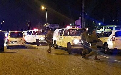 The scene of a terrorist attack outside the West Bank settlement of Ofra, on December 9, 2018. (Magen David Adom via Times of Israel)