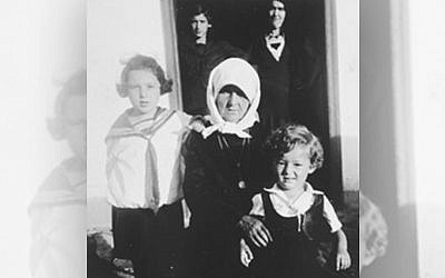 Shane's grandfather, Joe (Osche) Perl, as a young boy before the war, sitting on the lap of his grandmother Yetta Baila Gustein, along with his sister, Eva Ury, in the small shtetl, Ustye Zelenoye. Photo courtesy of Shane Brunswick.