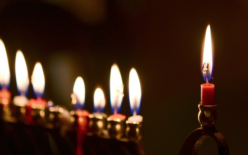 A Chanukah menorah lit on the eighth night. Flickr CC/slgckgc