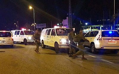 MDA responders attend at the scene of a terrorist attack outside the West Bank settlement of Ofra, on December 9, 2018. (Magen David Adom via Times Of Israel)