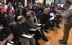Rabbi David Ingber conducts a class in March 2016 at Romemu, the Jewish Renewal congregation in New York that is opening a yeshiva next year. (Scott Osman via JTA)