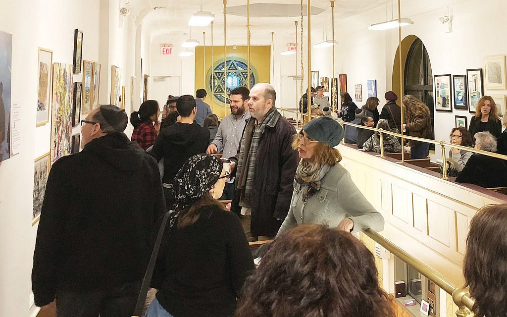 """The scene Sunday night at the """"Stanton 11"""" show held in the synagogue's newly renovated balcony gallery. Diana Halperin"""