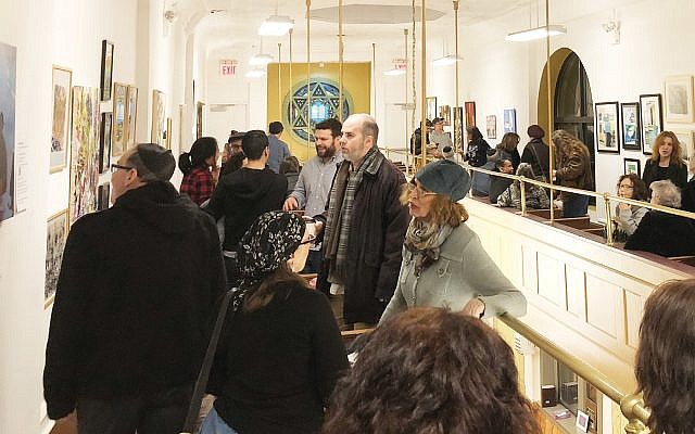"The scene Sunday night at the ""Stanton 11"" show held in the synagogue's newly renovated balcony gallery. Diana Halperin"