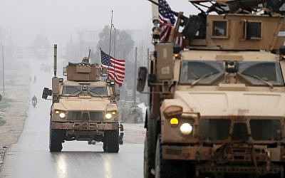 A U.S. troop convoy in Syria. A New York Times columnist argues that isolationist U.S. policy endangers Israel. Getty Images