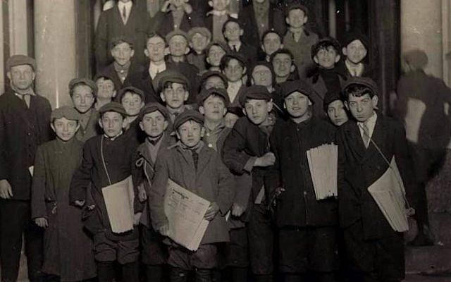 Newsboys for the Forward wait for their copies in the early morning hours, March 1913. (Lewis Hine/Wikimedia Commons)