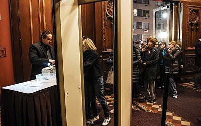 Three days after the Pittsburgh synagogue attack, people go through security at Central Synagogue before a memorial service for the 11 killed at the Tree of Life Synagogue. Getty Images