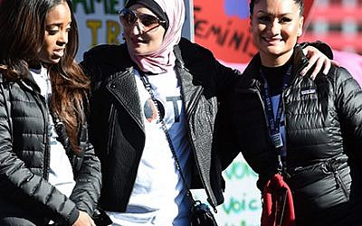 """Tamika Mallory, left, Linda Sarsour and Carmen Perez at the Women's March """"Power to the Polls"""" voter registration tour launch last January in Las Vegas. Getty Images"""