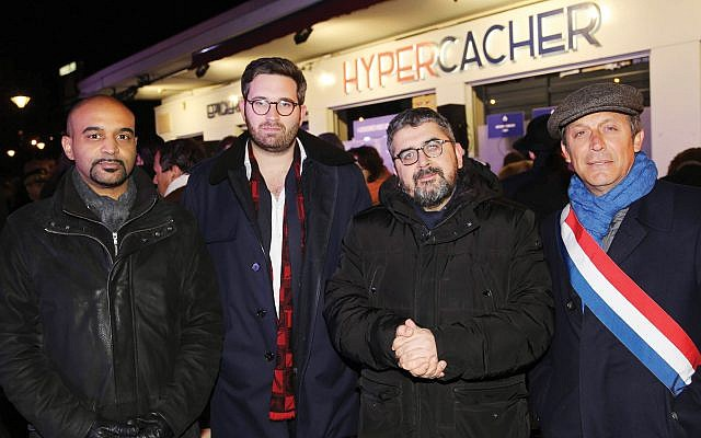 Dominique Sopo, left, Sacha Ghozlan, Mohamed Sifaoui and Sen. David Assouline attend the annual Jan. 9 commemoration for the victims of the 2015 jihadist attack at the HyperCacher store in Paris. Ghozlan is the president of the Union of Jewish Students of France. Alain Azria